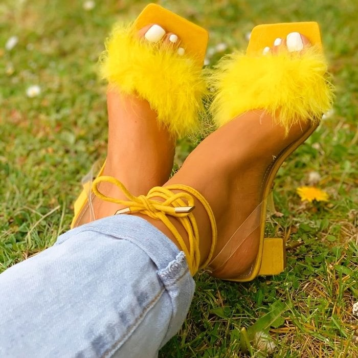Give your look an instantly cute touch with these yellow block heeled sandals