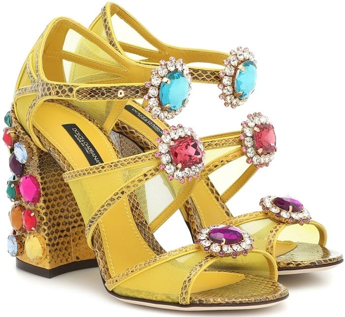 Crafted in Italy from a mixture of snake-effect leather and mesh panels, these golden sandals from Dolce & Gabbana are embellished with a multicolored assortment of crystal-encrusted jewels