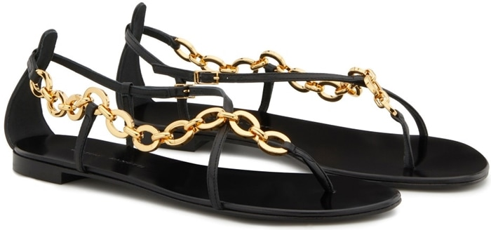 These leather sandals are embellished by a chain connecting the leather straps
