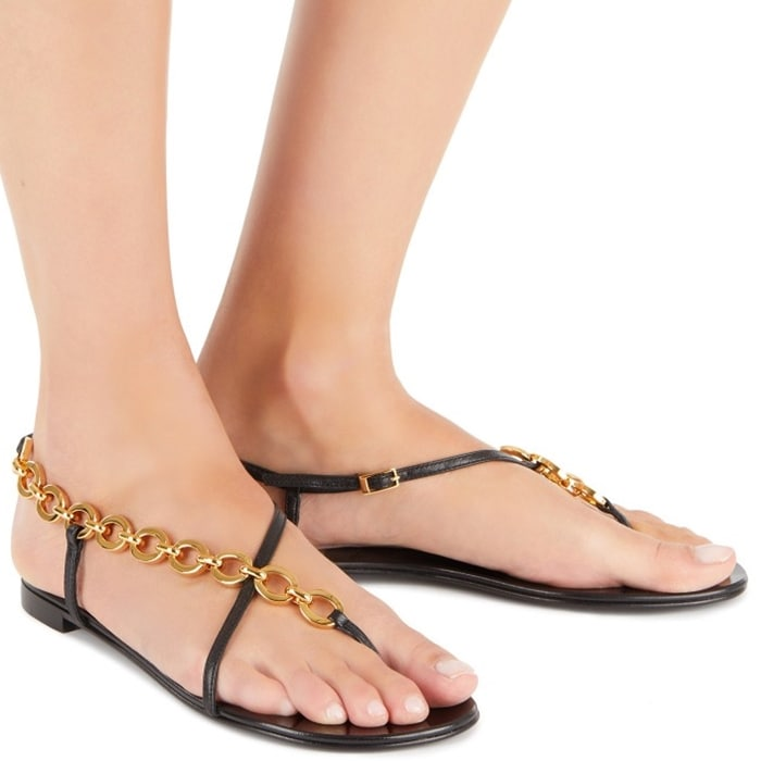 These summer leather sandals are embellished by a chain connecting the leather straps