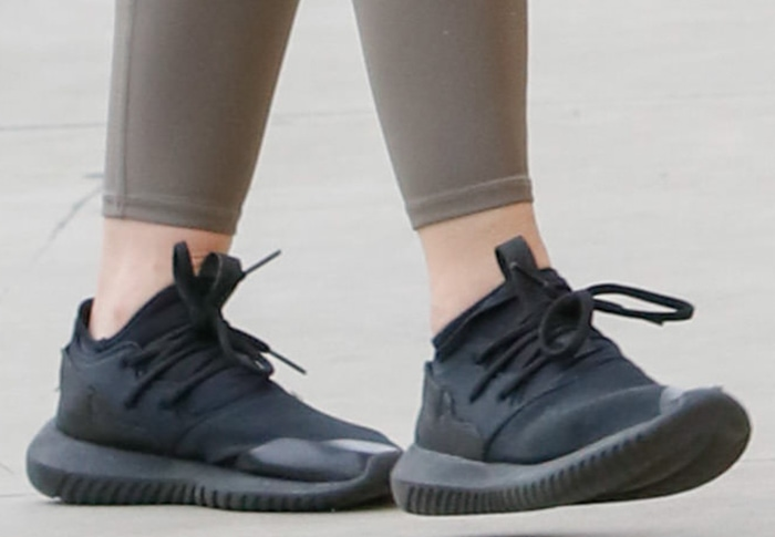 Lucy Hale completes her look with Adidas Originals 'Tubular' sneakers