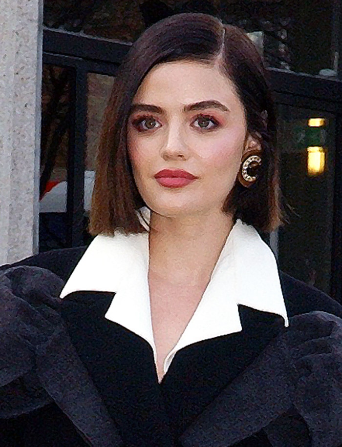 Lucy Hale wears dark pink makeup and styles her short bob straight with a side parting