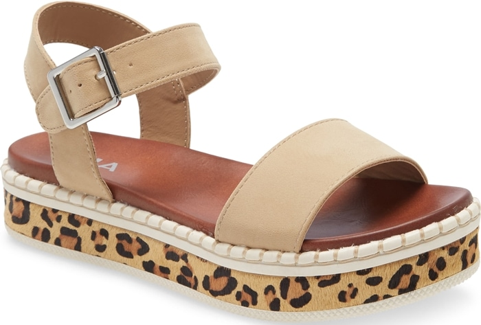 Leopard-print genuine calf hair covers the platform of a strappy sandal that makes sure every step you take is a fierce one