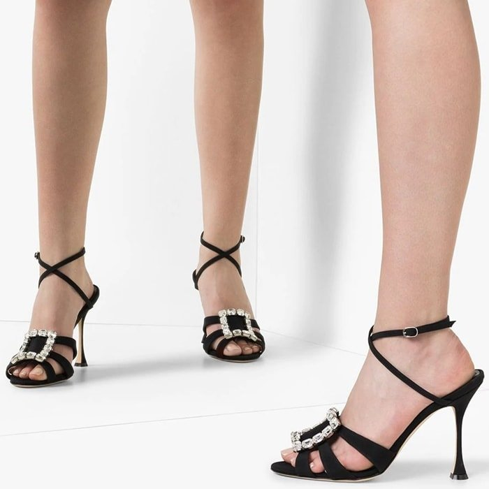 These black leather and satin Ticuna 105mm embellished-brooch sandals from Manolo Blahnik could snap into action at any given moment