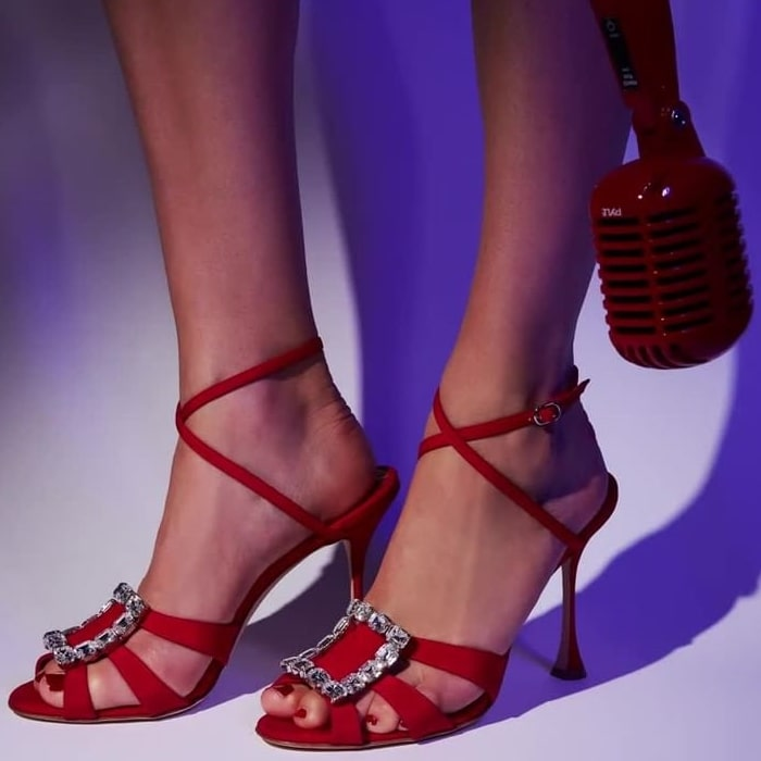 Red silk satin and leather Ticuna crystal sandals from Manolo Blahnik featuring crystal embellishments, an open toe, multiple front straps, a branded insole, an ankle strap with a side buckle fastening and a sculpted high heel