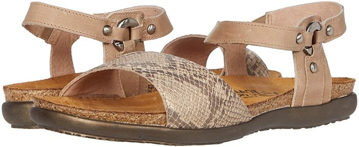 An earthy sandal is fashioned with burnished stud hardware and a curved, comfort-focused footbed to serve as a casual-chic go-to style