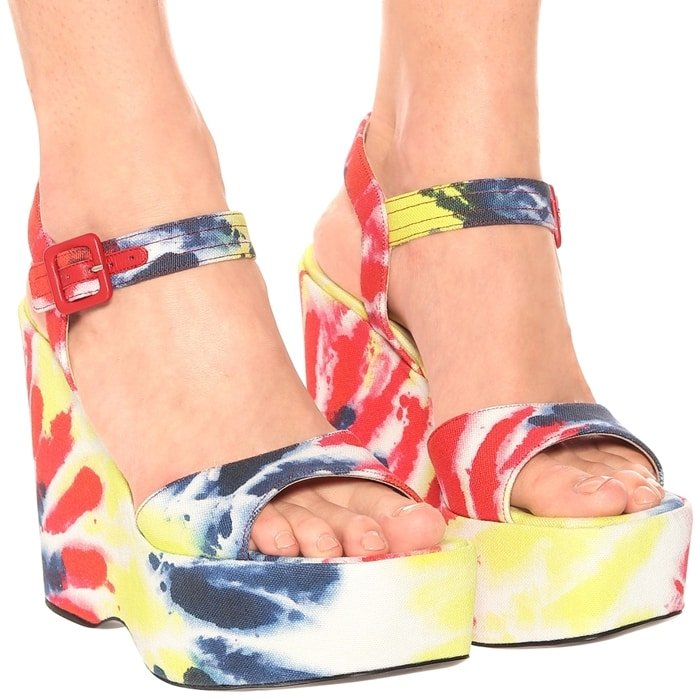 Set on towering platform soles, these sandals have a tie-dye fabric upper in a riot of color