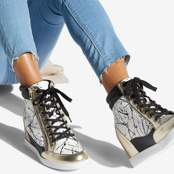 A street style wedge sneaker with a functional outer zipper detail and adjustable front laces