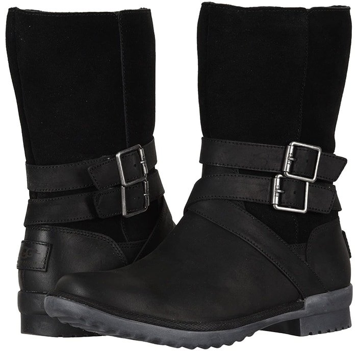 Double belts wrap the shaft of a weathered-looking boot crafted from seam-sealed waterproof leather and lined with warm UGGpure wool