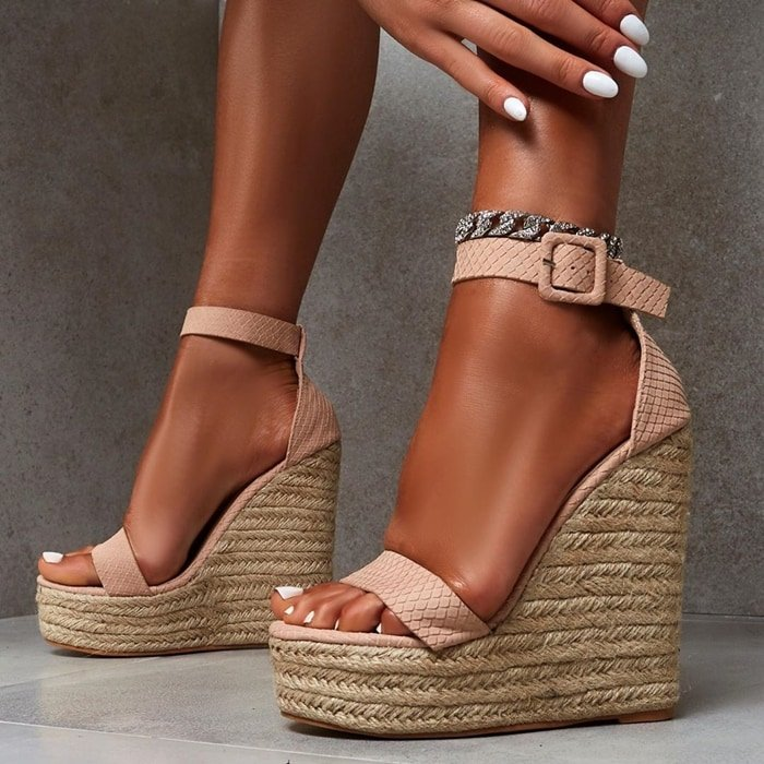 This summer-ready shoe features a woven espadrille platform wedge heel and toe strap and wrap-around ankle strap