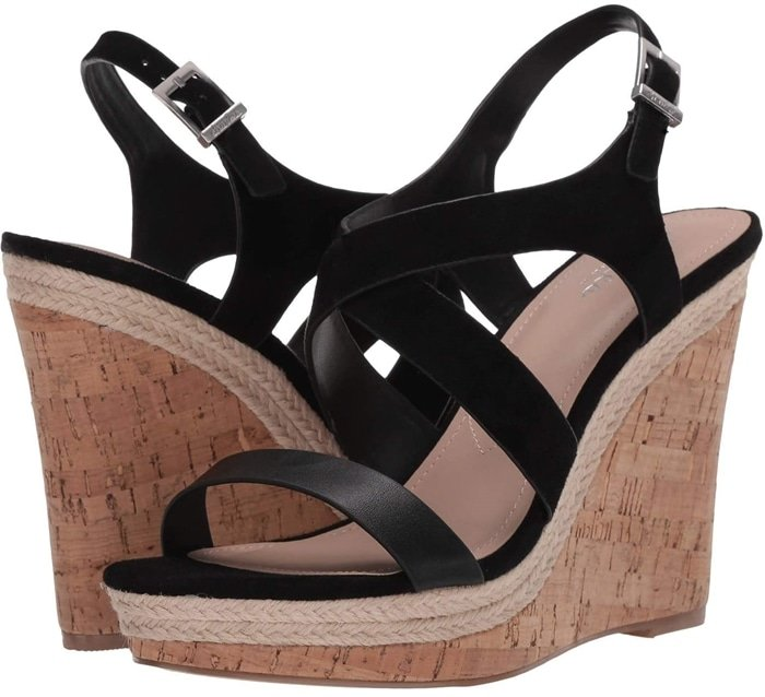 A cork-textured wedge provides a dramatic finish for this strappy statement sandal