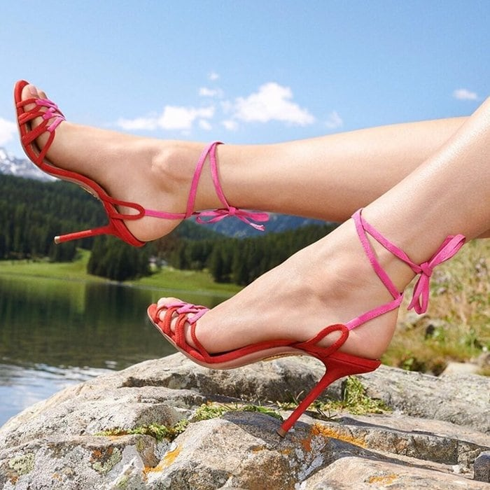 Delicate colorblock suede straps encircle the ankle and cross the toes of these stiletto sandals