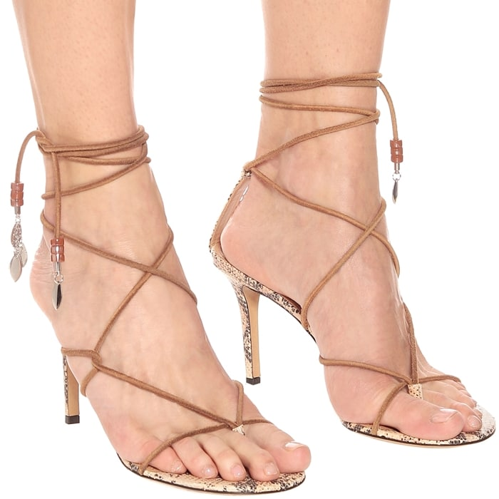 Isabel Marant's free-spirited aesthetic is apparent in these tan Askee sandals, which are intricately laced around the foot with slim cord