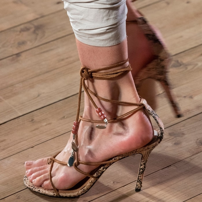 Beading trims the laces of the Askee sandals from Isabel Marant, with charms that mimic the silver-toned leaves seen on the brand's jewelry