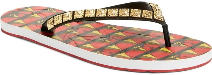Dazzling golden studs light up a stylish Spanish flip-flop featuring a footbed stamped with an eye-catching and colorful pyramid print