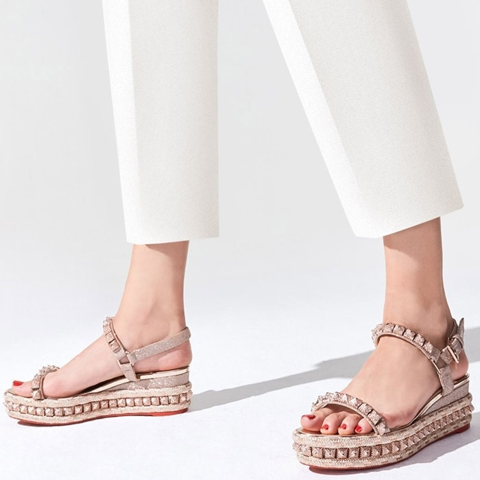 Shiny textured pyramidal studs and a tonal braided trim wrap around the sandals' 60mm silver leather wedge sole
