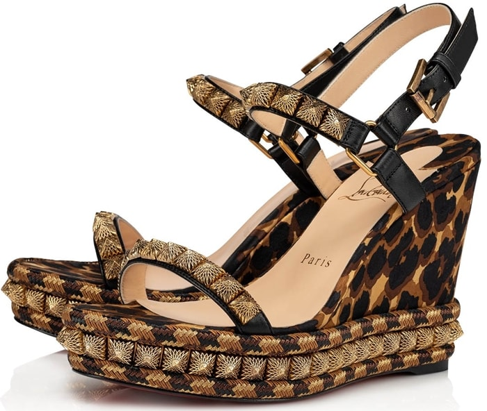 Set atop a platform wedge sole, these silk and leather leopard-print sandals are elevated with faceted metallic studs