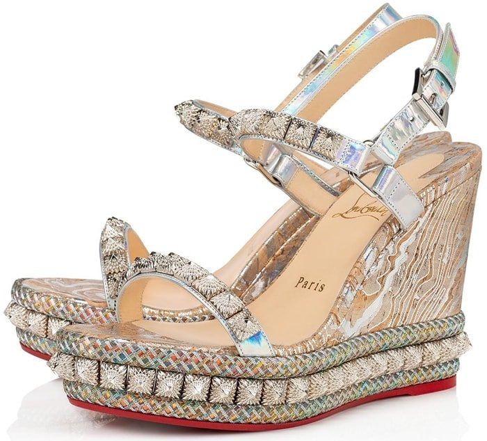 Set atop a platform wedge sole, these abstract-print sandals are elevated with faceted studs and multicolor trim