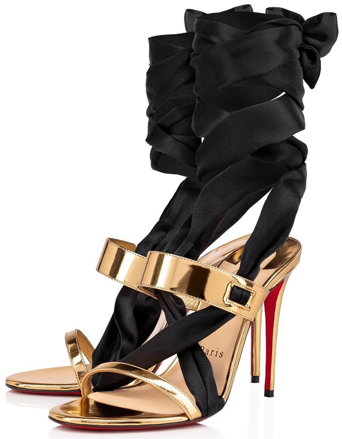 Metallic leather sandals have a luxurious satin ankle-tie strap