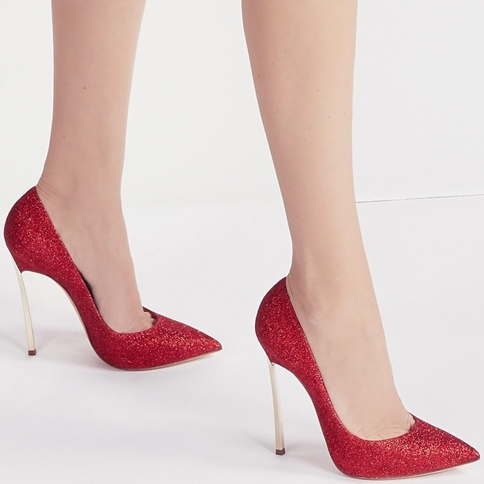 The perfect middle ground between femininity and design, these glittery fabric pumps with their iconic heel will be your luxurious accessory perfect for any occasion