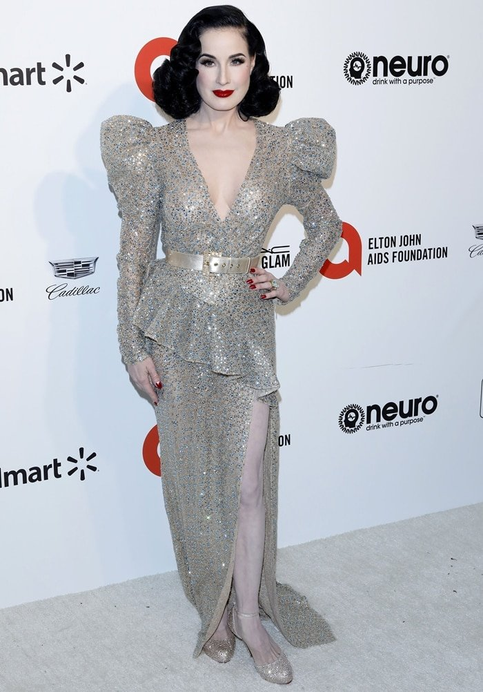 Dita Von Teese wearing a gold sequined dress at the 28th Annual Elton John AIDS Foundation Academy Awards Viewing Party