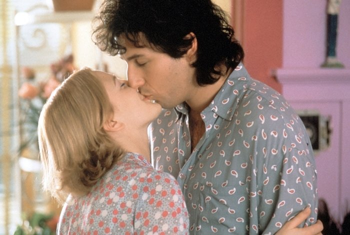 Drew Barrymore and Adam Sandler kissing in The Wedding Singer, a 1998 American romantic comedy film