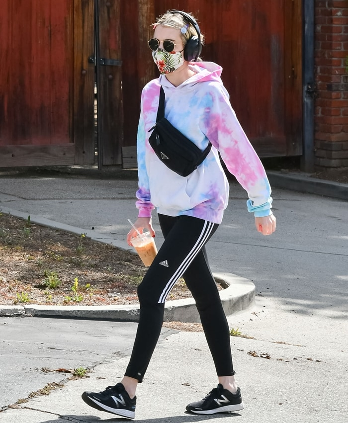 Emma Roberts wearing Adidas soccer pants while going on a coffee run
