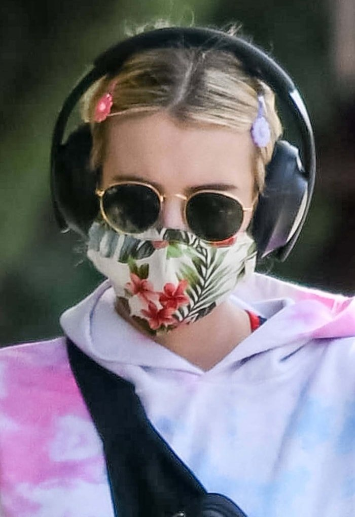 Emma Roberts rocks a floral face mask, Ray-Ban sunglasses, and Scunci girl flower snap clips