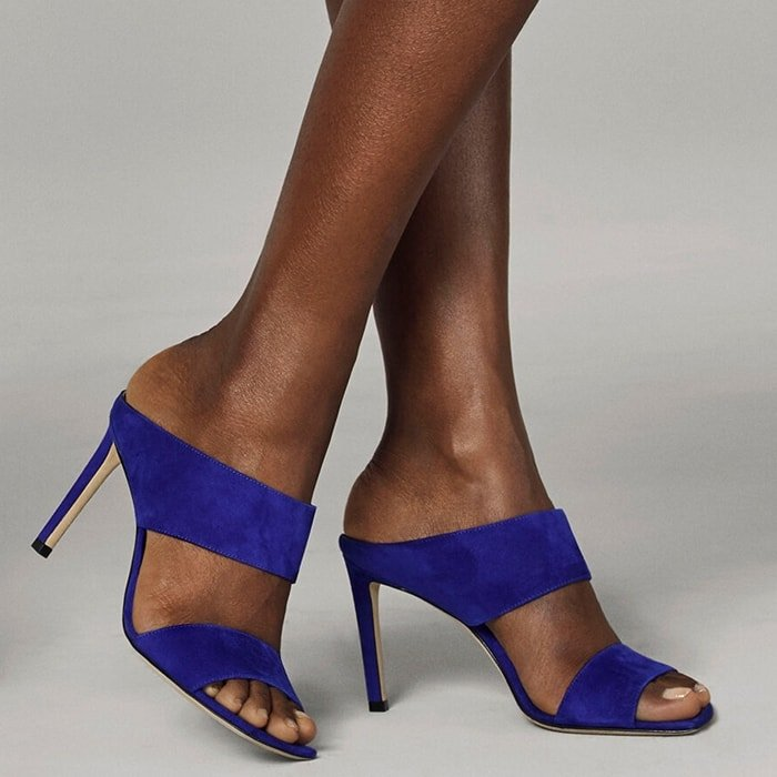 These plush cobalt suede Hira mules epitomize effortless glamour