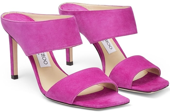 These plush magenta suede HIRA 85 mules epitomize effortless glamour