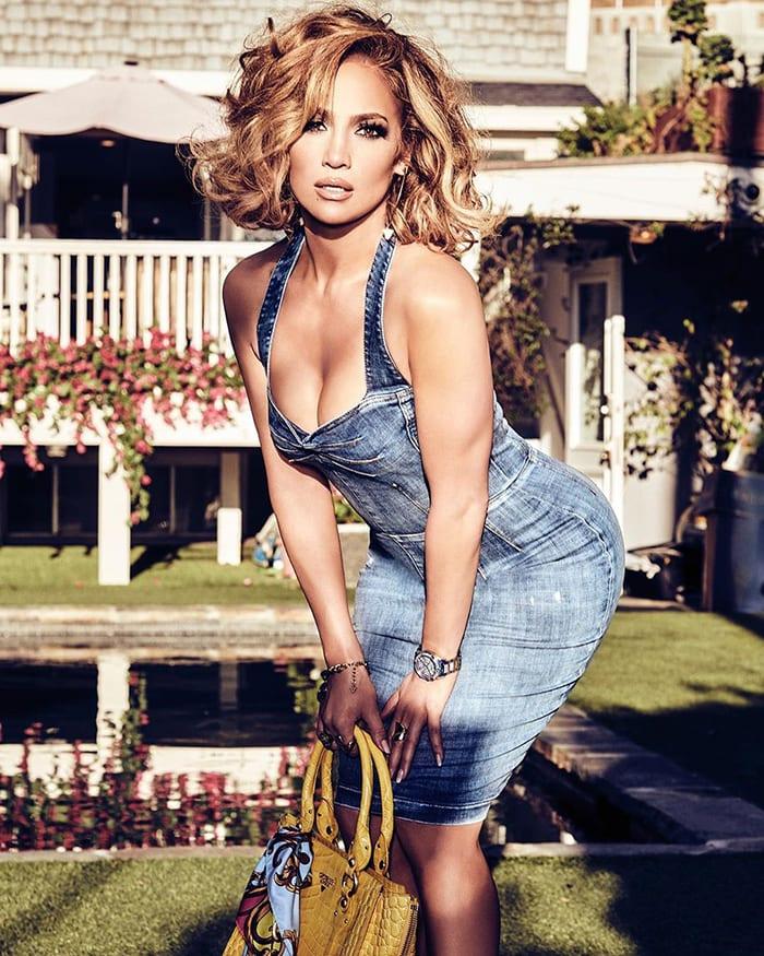 Jennifer Lopez shows off her curves in a Guess denim blue mini dress