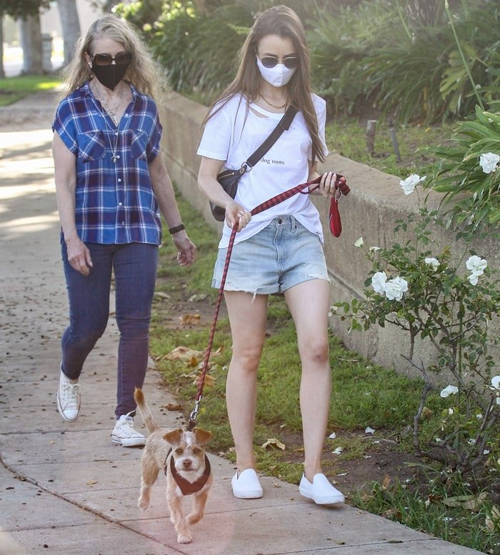 Jill Tavelman and Lily Collins wear masks while taking pup Redford out for a walk
