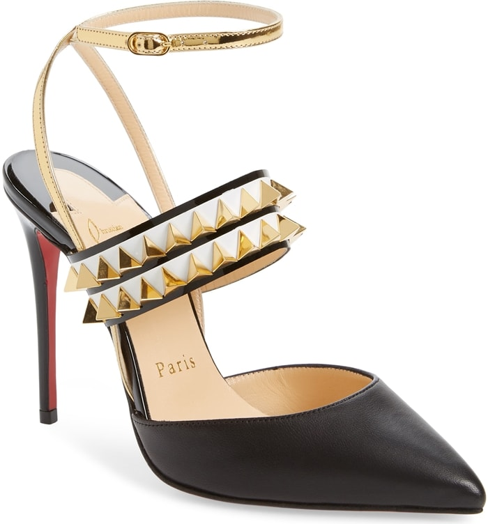 A golden ankle strap, gilded studs and a willowy stiletto heel sharpen the look of a pointy-toe pump with an attitude that says you've got nothing to prove