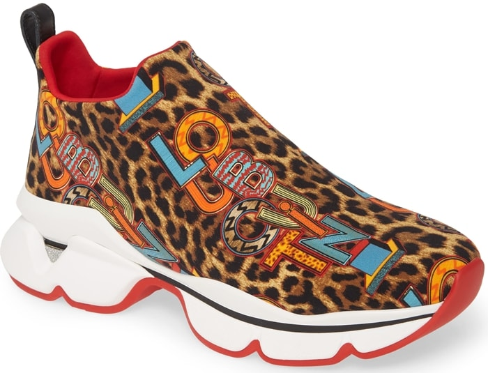 Jazzy logo letters overlay a leopard print on a sporty-chic sneaker set on a chunky, waved platform with that iconic Louboutin-red sole