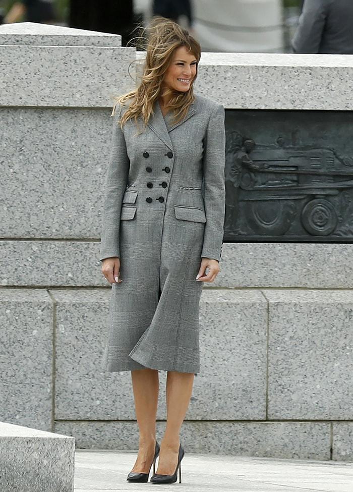 Melania Trump in a gray Altuzarra plaid coat dress and Manolo Blahnik pumps