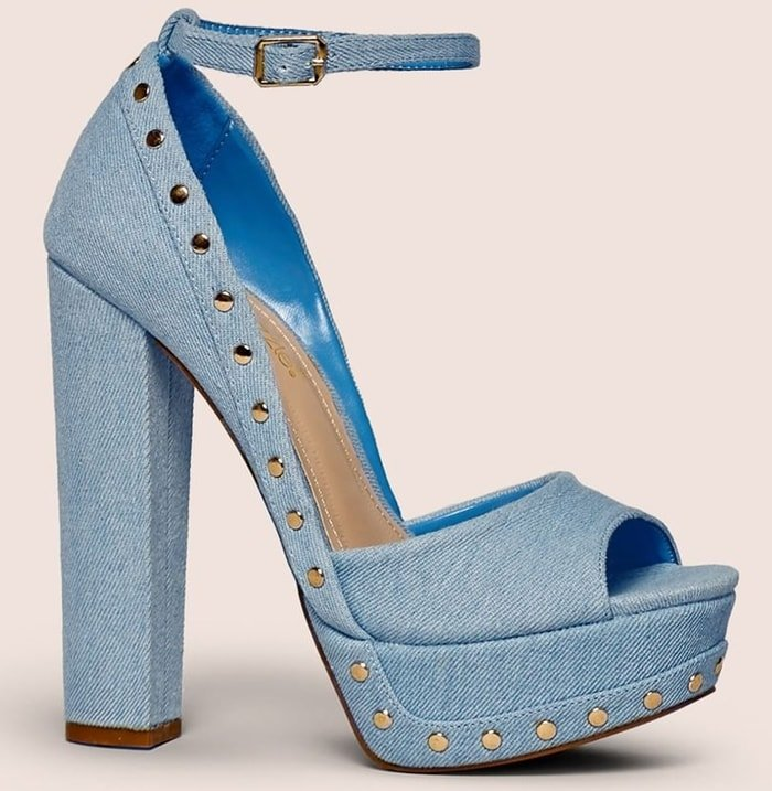 An open-toe denim pump with a chunky platform, stud detailing, and side buckle closure