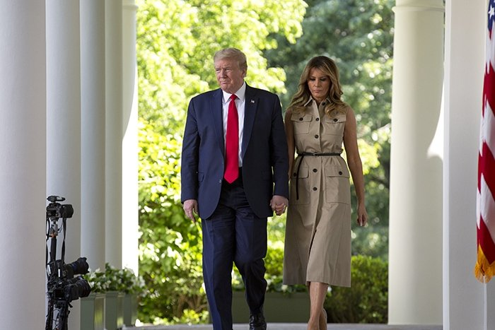 President Donald Trump and First Lady Melania Trump hold hands before taking the podium during the National Day of Prayer on May 7, 2020
