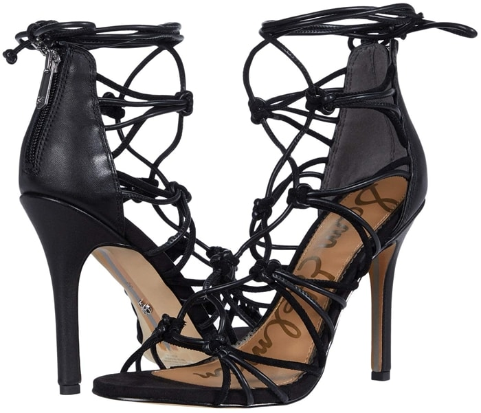 Slim straps are knotted together and woven up the vamp of a blacksandal lofted by a tapered heel