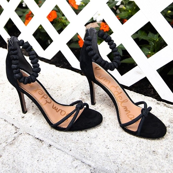 Silk ankle detailing with a knotted toe strap makes these sandal heels party-ready