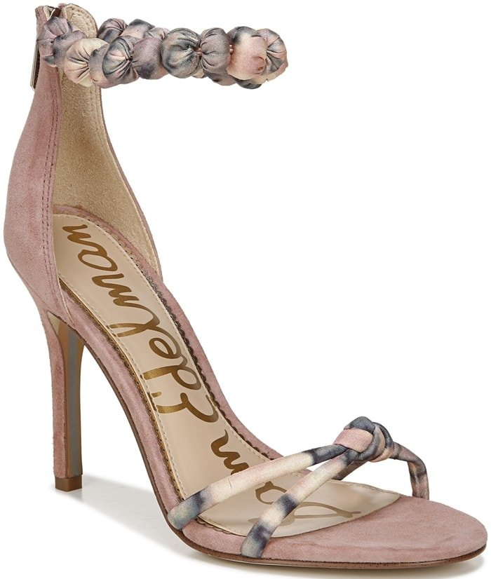 Gathered styling highlights the ankle strap of a lofty stiletto sandal that's ready to make a statement