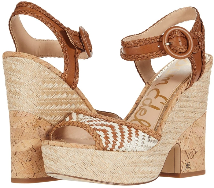 Summery mixed media covers every part of this towering peep-toe sandal that has espadrille DNA and ultramodern verve