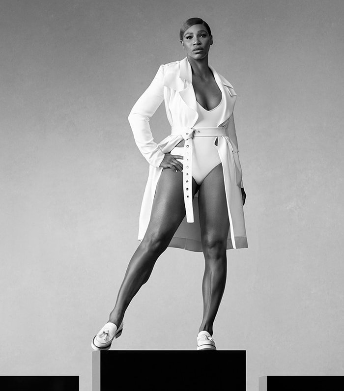Serena Williams in a low-cut leotard with a trench coat
