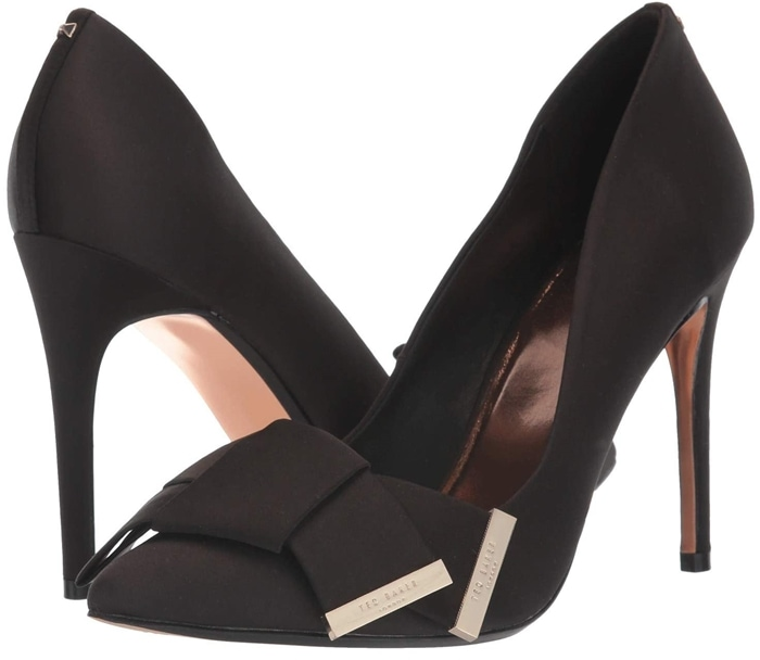 Logo-embellished hardware accentuates the bold bow ornament of this black pointed-toe stiletto pump