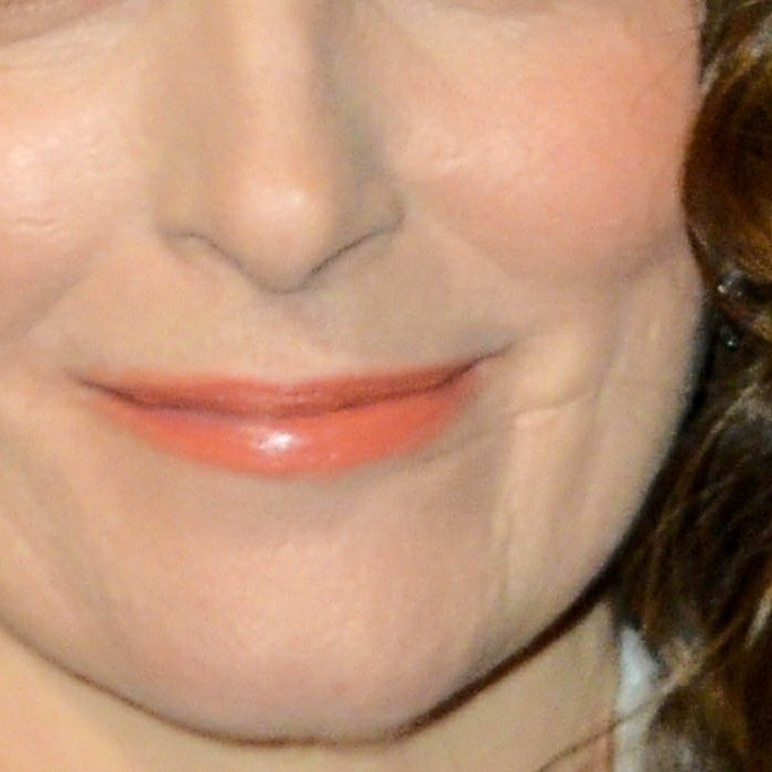 Tina Fey has a thin scar on the left side of her face