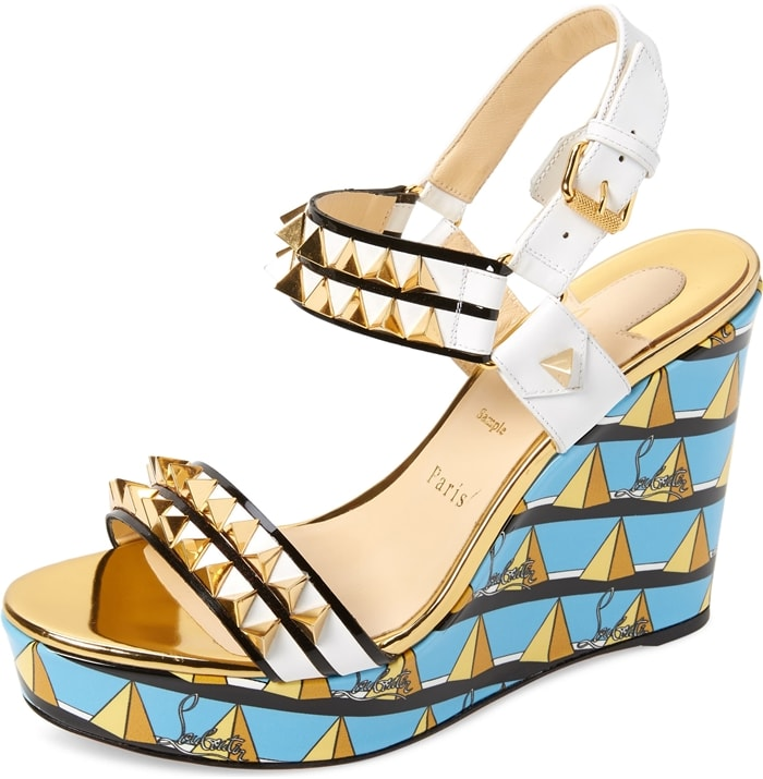 A slingback sandal doubles down on the edgy attitude with dangerous-looking spikes punctuating the straps and a colorful print wrapping the platform wedge