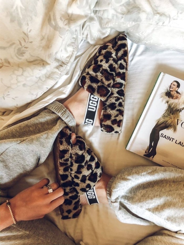 Step out in style with this genuine-shearling leopard print slingback that combines the warm-weather appeal of a sandal with the plush comfort of your favorite slipper