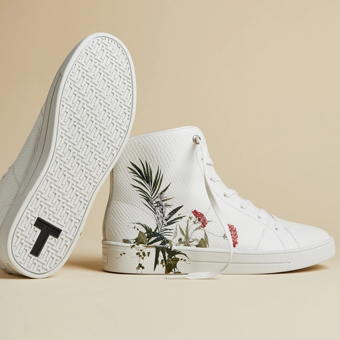 This high-top sneaker is crafted with a croc-print embossed leather upper, and features a leafy print and a metallic inset along the heel
