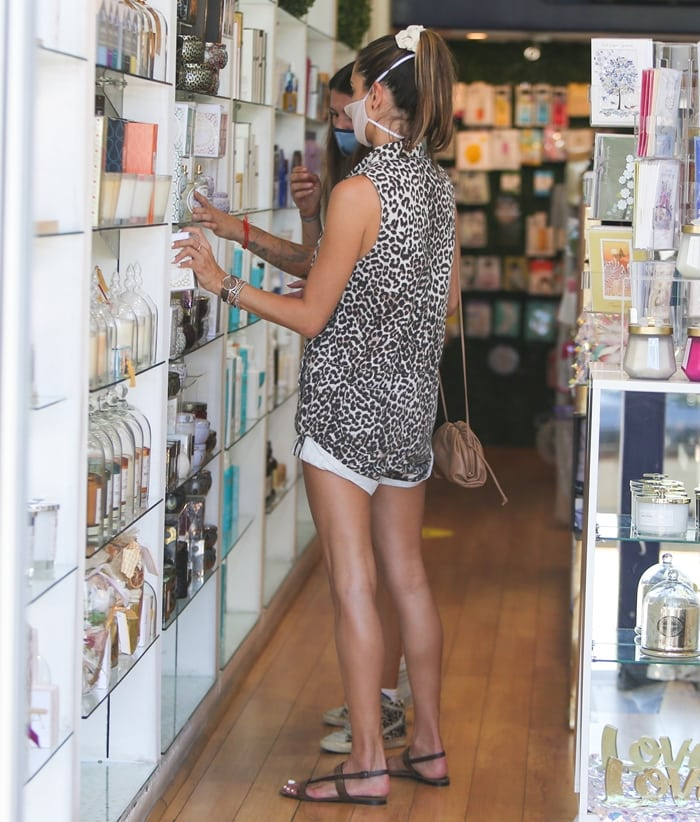 Alessandra Ambrosio flaunts her legs in One Teaspoon's Mini Braxton leopard print denim zip-up romper in a durable cotton drill