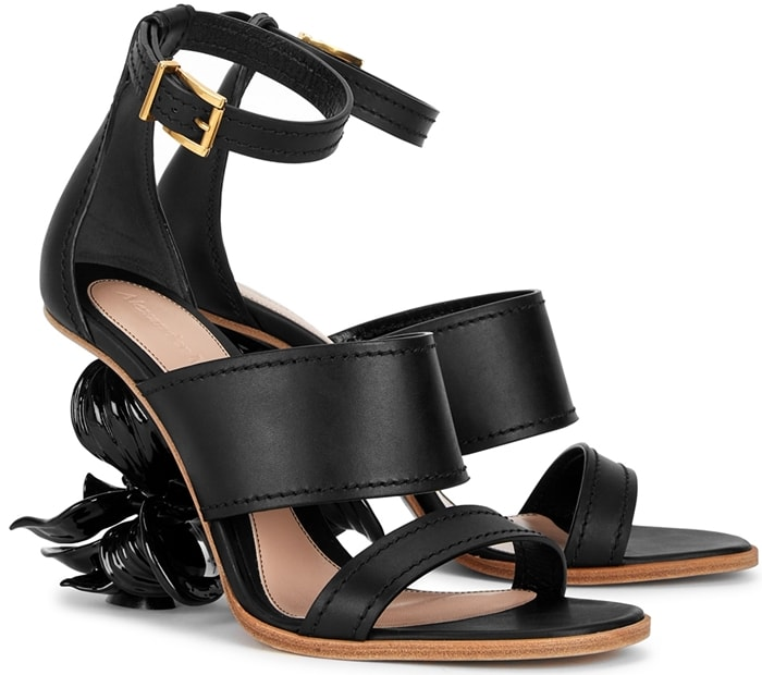 Black Alexander McQueen No.13 80 flower wedge leather sandals feature a lacquered magnolia flower heel and straight strap silhouette