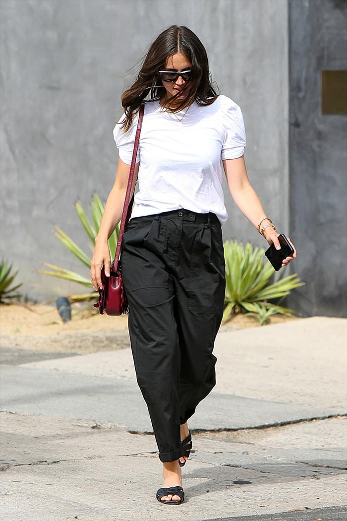 Ana de Armas wears a white A.L.C. top with black Nili Lotan pants